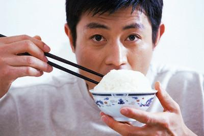 Man Eating Bowl of Rice