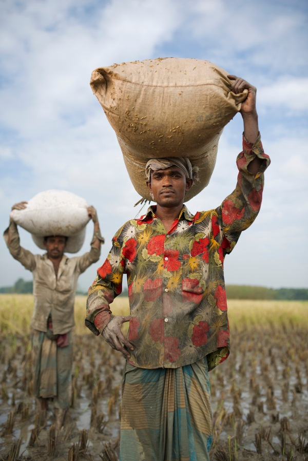 Farmers carrying their produce